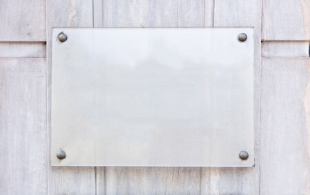Blank transparent sign plate mockup, Name plate template on the wall