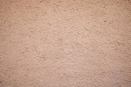 Brown, beige color, plaster rough painted background texture, building facade wall grunge material