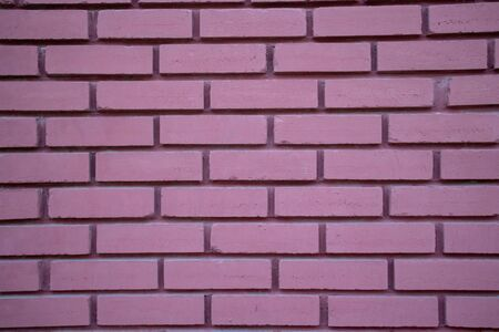 Vintage purple color brick wall background and texture, building facade wall grunge material Stock Photo