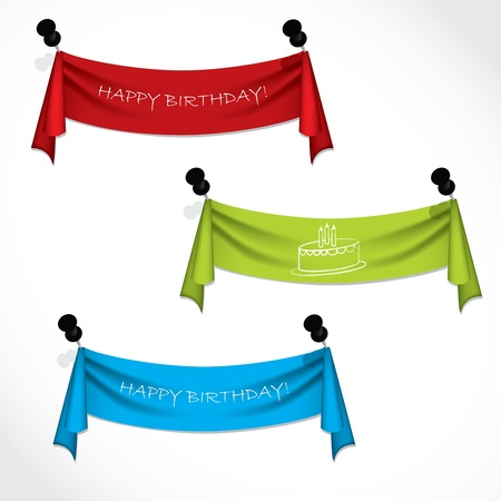 push pins: Happy birthday ribbons hanging on push pins