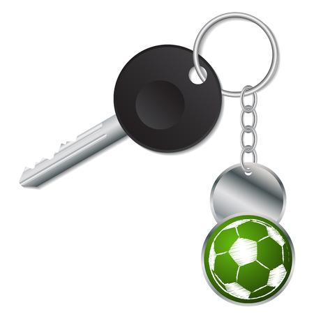 keyholder: Black key with metallic soccer ball keyholder on white Illustration