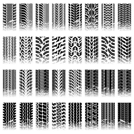 neumaticos: Treinta y dos piezas de grunge enlosables patrones pista del neum�tico Vectores