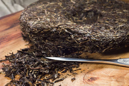 pu: Breaking puer tea cake with a puer tea knife