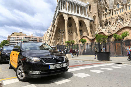 BARCELONA, SPAIN - May 3, 2018 : La Sagrada Familia - the impressive cathedral designed by Gaudi, which is being build since 19 March 1882 and is not finished yet May 3, 2018 in Barcelona, Spain.