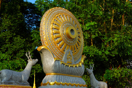 Wheel of life : Dhamma for Release. The details of the ancient texts around The wheel of life symbol are We protect virtue so that virtue will protect us. Stock Photo