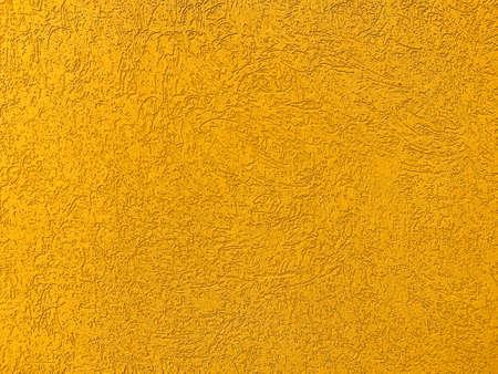 Exterior yellow grunge texture concrete wall, closeup Stock Photo