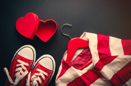 heart shaped: photo of jacket on hanger, cute heart shaped box and red gumshoes on the wonderful black studio background