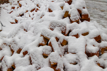 Red bricks covered with snow