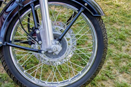 Bike front disc brake close up view from right side, motorbike or motorcycle braking mechanism