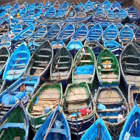 Blue fishing boats in port Morocco photo