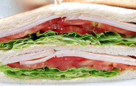 sandwiches: closeup of two sandwiches in a white plate Stock Photo