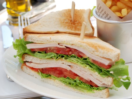 cuisine entertainment: closeup of two sandwiches in a white plate Stock Photo