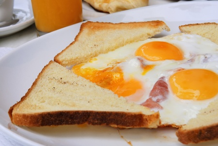 English breakfast with fried eggs, bacon and toast photo