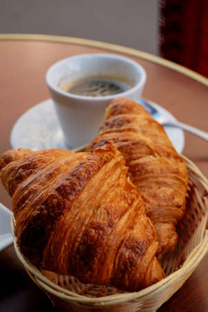 close-up of french breakfast with two croissants in basket and coffee  photo