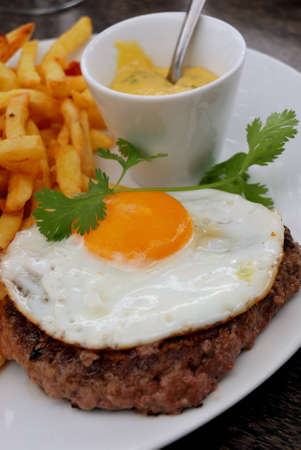 delicious isolated american burger with prepared egg on table  photo