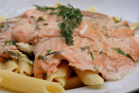 close-up of plate of spaghetti and fresh salmon with cream sauce   photo