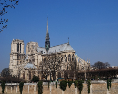 catholocism: View of the stunning Notre-Dame Cathedral of Paris with blue sky for adding your design