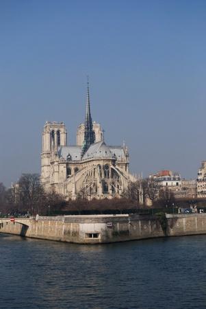 catholocism: View of the stunning Notre-Dame Cathedral of Paris along the Seine River, in Ile de la Cité, Paris