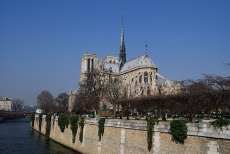 View of the stunning Notre-Dame Cathedral of Paris along the Seine River, in Ile de la Cit�, Paris  photo