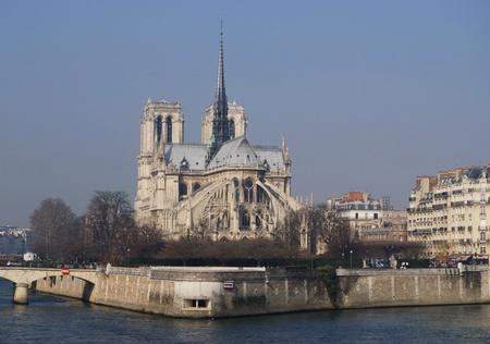 catholocism: View of the stunning Notre-Dame Cathedral of Paris along the Seine River, in Ile de la Cit�, Paris