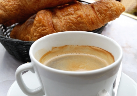 close-up of french breakfast with croissants and coffee photo
