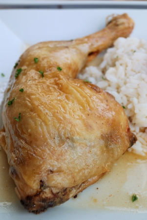 delicious isolated roasted chicken leg in white plate photo