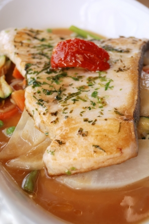 fillet of fish with vegetables under the fish  photo