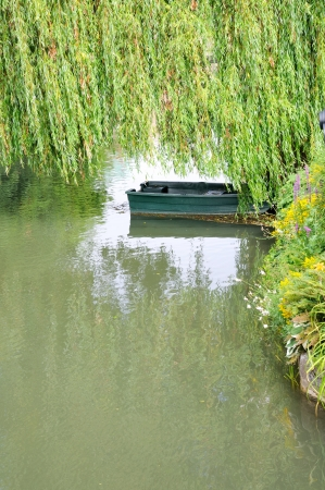 green boat: view of a green boat on a river