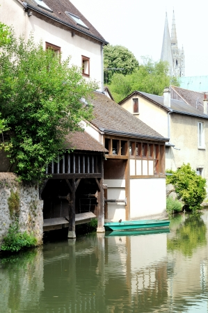 green boat: view of a green boat on the river LEure, Chartres, France Stock Photo