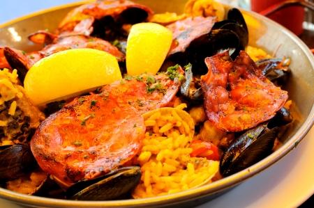 safran: close-up of delicious isolated paella : classical spanish recipe
