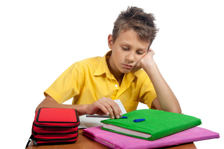 boyhood: Boy with colored books looking bored. All on white background.