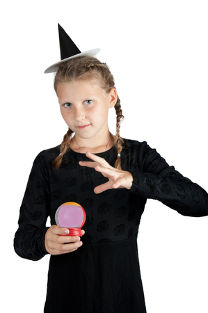costume ball: girl in halloween costume of witch with magic ball isolated on white background Stock Photo