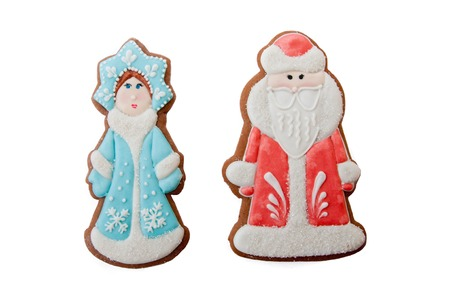 'ded moroz': russian Christmas characters Ded Moroz Father Frost and Snegurochka Snow Maiden cookies isolated on white