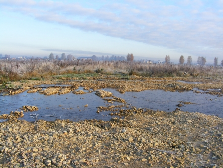 View on puddle of water and field Stock Photo - 14238648