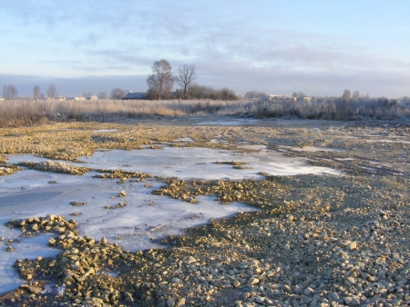 View on frozen puddle of water and field Stock Photo - 14238649