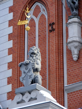 Sculpture of lion holding shield decorating House of the Blackheads in Riga, Latvia