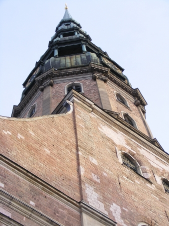 saint peter: Saint Peter cathedrale spire in Riga, Latvia on sky background