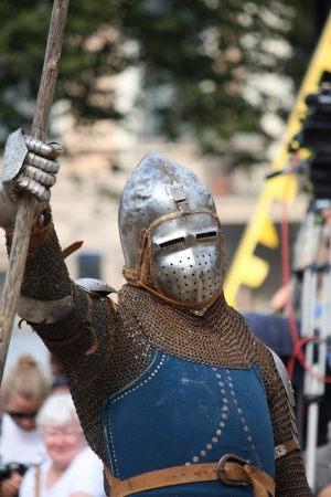 musculine: RIGA, LATVIA - AUGUST 21: Unidentified man from historical reconstruction club Sword and Raven inmetal  armor and helmet during Riga Festival on August 21, 2011 in Riga, Latvia