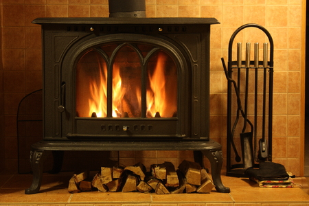 Fire burning in the cozy fireplace Archivio Fotografico