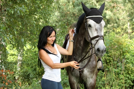 gray horse: Beautiful woman and gray horse portrait in green garden Stock Photo