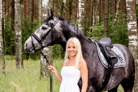 gray horse: Beautiful blonde woman and gray horse in forest portrait