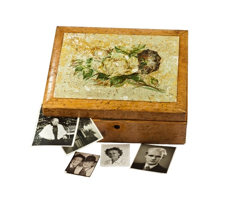 Old shabby chic wooden box with old photos, isolated Banco de Imagens