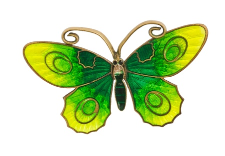 Old green and yellow butterfly brooch isolated