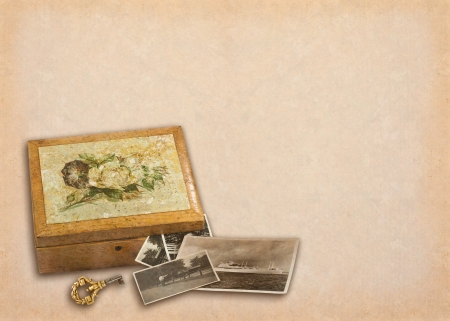 Old wooden box with painted roses, old photos and a key photo