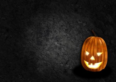 Textured black halloween background with jack o lantern pumpkin Banco de Imagens
