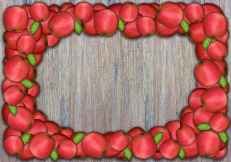 Fresh red apples on a wooden wall