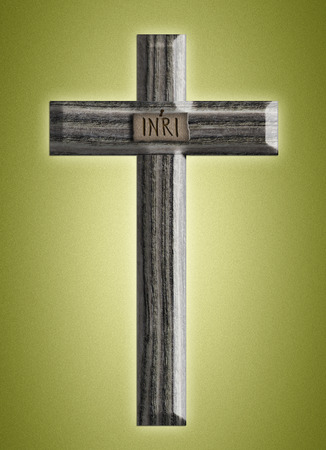 Wooden cross on a green background