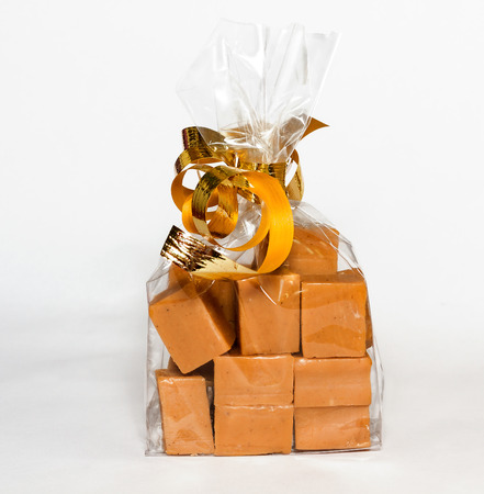 Fudge gift in clear bag on white background. Fudge with Gingerbread  tastetaste