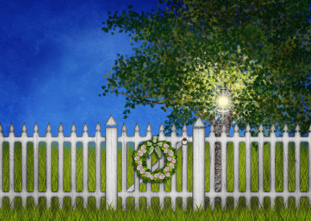 White fence and gate with wreath, lantern in the tree