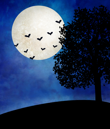 Halloween moon over desolate landscape with a lonely tree and bats flying in the sky